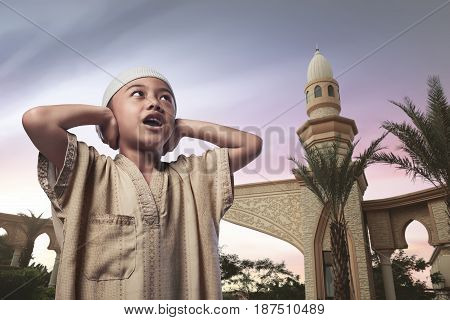 Asian Muslim Child With Traditional Dress Praying