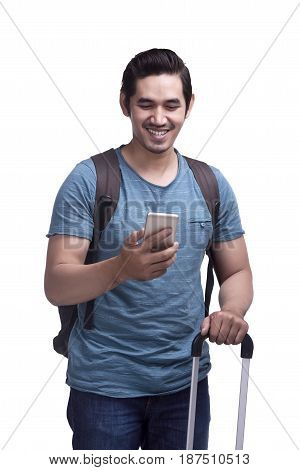 Happy Asian Male Traveler With Bags And Mobile Phone