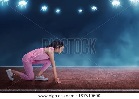 Beautiful Asian Woman Athlete Ready To Running In Starting Line
