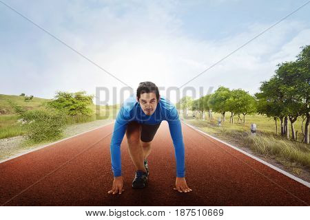 Athlete Asian Man On Starting Line Ready To Running