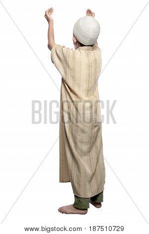 Back View Of Asian Muslim Kid Raising Hand And Praying