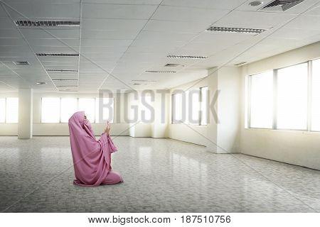 Young Asian Muslim Woman Wearing Niqab Praying To God