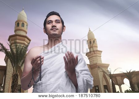 Young Asian Muslim Man Wearing Ihram Clothes
