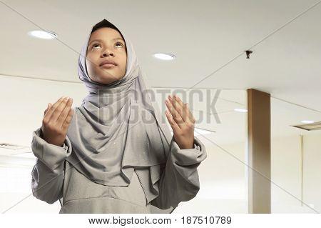 Portrait Of Asian Muslim Child Wearing Hijab Dress Praying