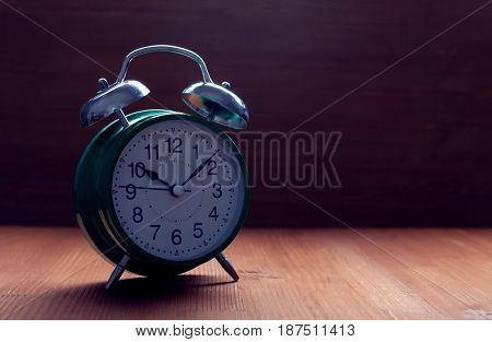 classic green alarm clock night slip time