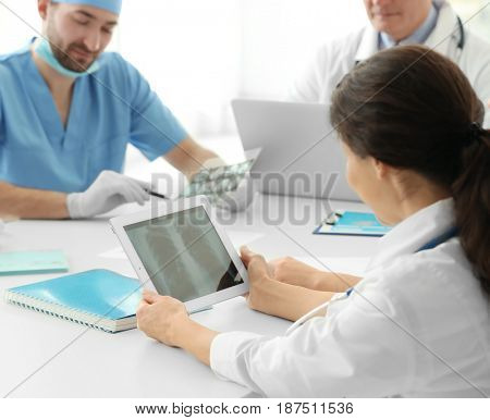 Young doctor exploring lung roentgenogram in clinic