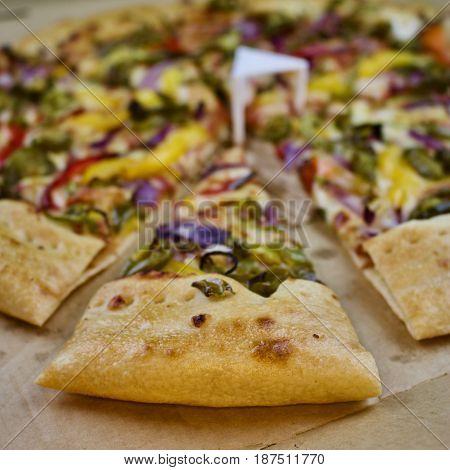 Tasty slice of vegetarian fresh pizza in delivery box