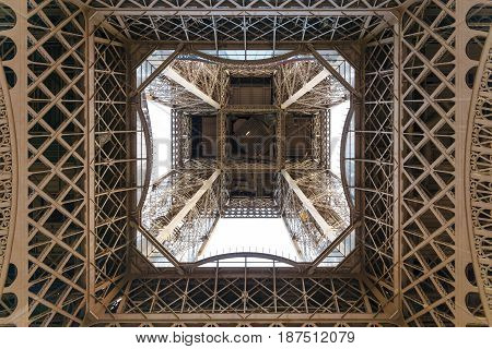 Paris France - May 1 2017: The Eiffel Tower with a cloudy day in the evening take in uprisen angle view from a ground on May 1 2017 in Paris France.