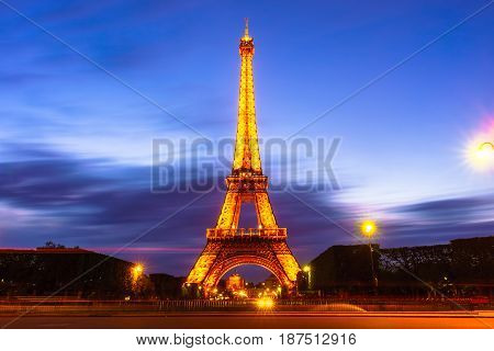 Paris France - May 1 2017: Long Exposure view of Eiffel tower view from Champ de Mars in the twilight with a blue sky in a background on May 1 2017 in Paris France.