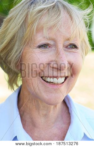 Head And Shoulders Outdoor Portrait Of Senior Woman