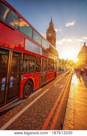 Big Ben With Double Decker Bus Against Colorful Sunset In London, Uk
