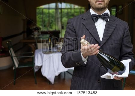 Waiter Serving Champagne Flutes During A Celebration
