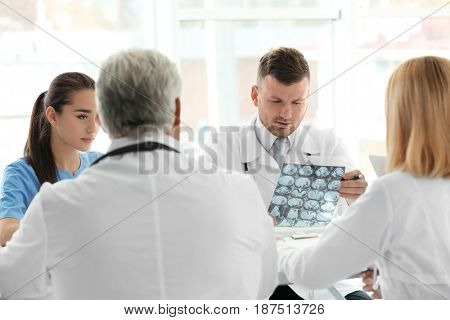 Team of doctors having meeting at clinic