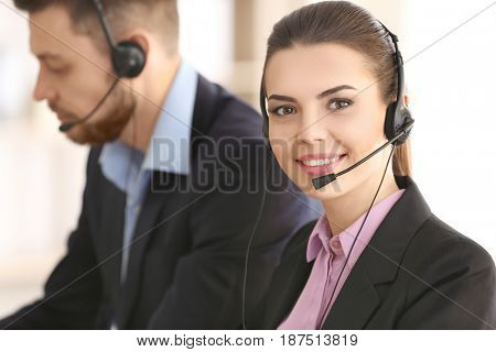 Young woman with headset working in office
