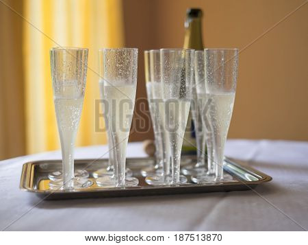 Champagne flutes ready to serving in a restaurant