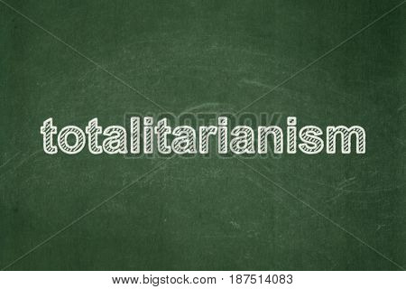 Politics concept: text Totalitarianism on Green chalkboard background