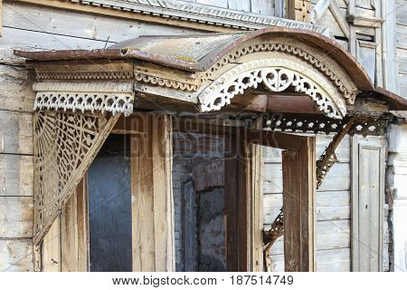 The porch of an abandoned old house in Russian province