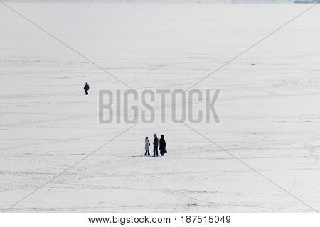 People walk on the river ice in winter, Russia, the Volga river, Saratov