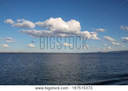River landscape, clouds over the river. Volga, Russia