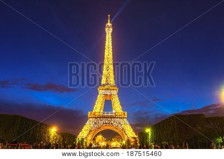 Paris France - May 1 2017: Long Exposure view of Eiffel tower view from Champ de Mars in the night with a blue sky in a background on May 1 2017 in Paris France.