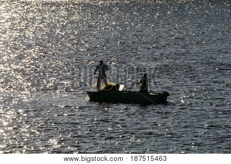 Fishermen on the river in a motor boat.