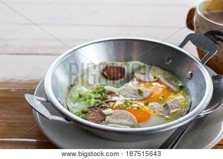 Fried eggs in a frying pan with sausage with pork mixed black pepper Breakfast Healthy food.