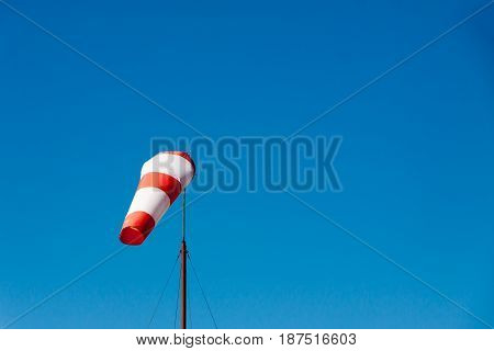 Airport windsock on clear blue sky background in clear day