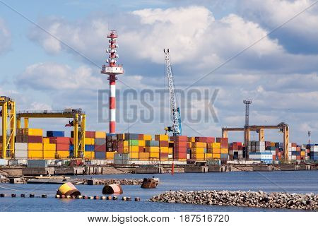 seaport with the containers which are on it in clear summer day