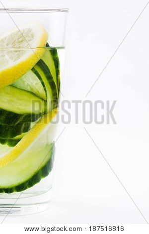 Detox water with cucumber and lemon isolated on white background