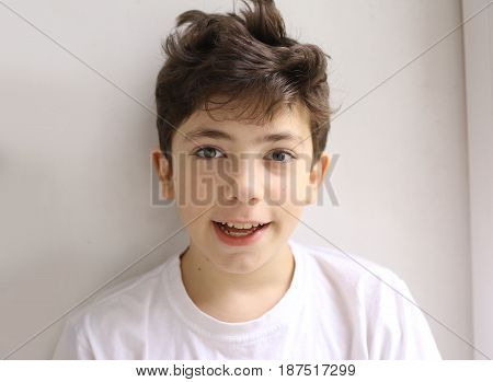 teen smiling happy boy with shaggy hair close up photo