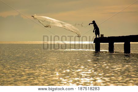 Men fishing on Silhouette on the Beach songkhla thailand
