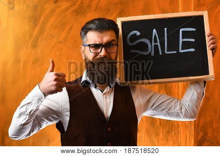 Bearded Man, Brutal Caucasian Hipster Holding Sale Inscription On Blackboard