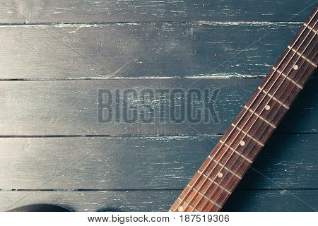 Electric guitar body and neck detail on wooden background