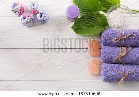Spa treatment and aromatherapy top view background with copy space on white wood. Aroma salt, herbal balls for indian spa