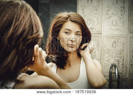 Woman take care of her beauty.
