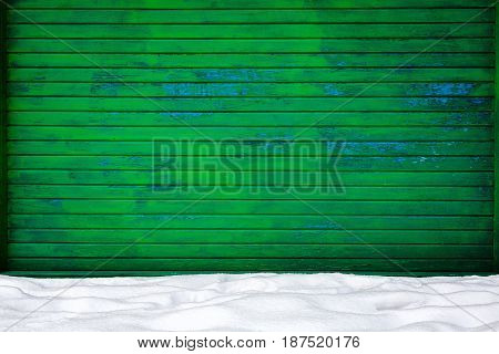 Green wood plank wall in snow. Architecture detail background
