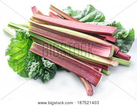 Edible rhubarb stalks on the white background.