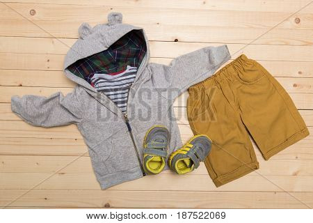 baby clothes for boys on wooden background