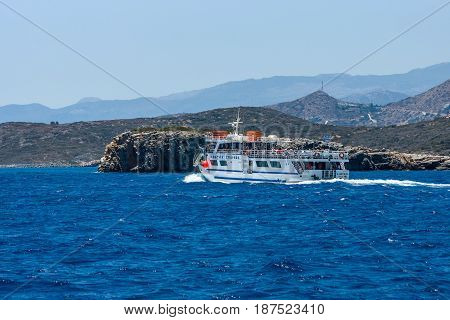 CRETE GREECE - JULY 11 2016: Pleasure ship with tourists on the sea. View from the sea on the north coast of Crete.