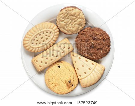 Mix of shortbread cookies in plate on white background top view