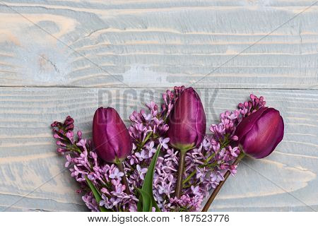 Veterans Day Concept. Lilac Flowers With Tulips On Blue Vintage