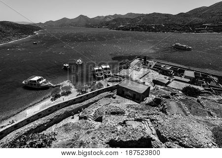 CRETE GREECE - JULY 11 2016: View of the Gulf of Elounda from a fortress on Spinalonga island. Black and white.