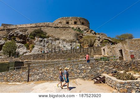 CRETE GREECE - JULY 11 2016: Tourists on Spinalonga island and fortress of the same name. View from the sea.