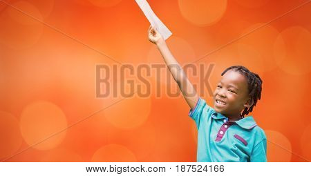 Digital composite of Happy girl holding document against orange background
