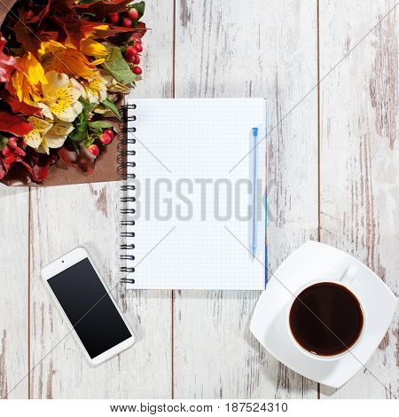 Phone, coffe and notebook for planning. Empty list