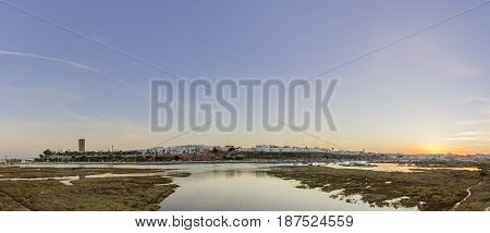 Panoramic sunset view of Rabat from Bouregreg river in Sale Morocco.