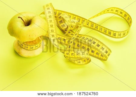 Diet Concept Represented By Apple Tied With Measure Tape