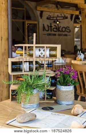 CRETE GREECE - JULY 11 2016: One of the outdoor restaurants of a coastal elite tourist town Agios Nikolaos on the Greek island of Crete.