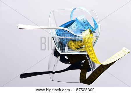 Bowl Of Measuring Tapes Of Yellow And Blue Colors