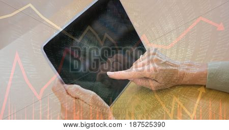 Digital composite of Digital composite image of hands using tablet PC with binary code and graphs